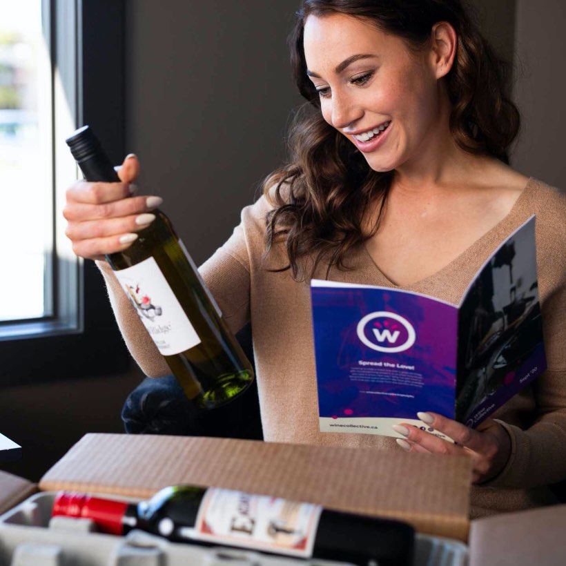 Women opening wine subscription box from Wine Collective