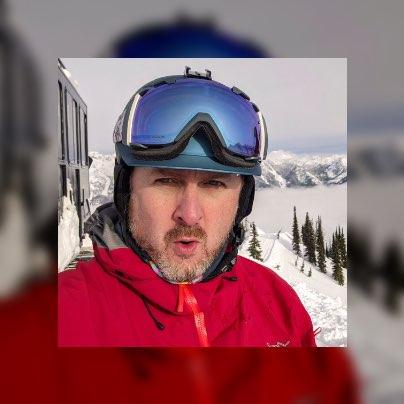 A close up of john wearing his snowboard gear.