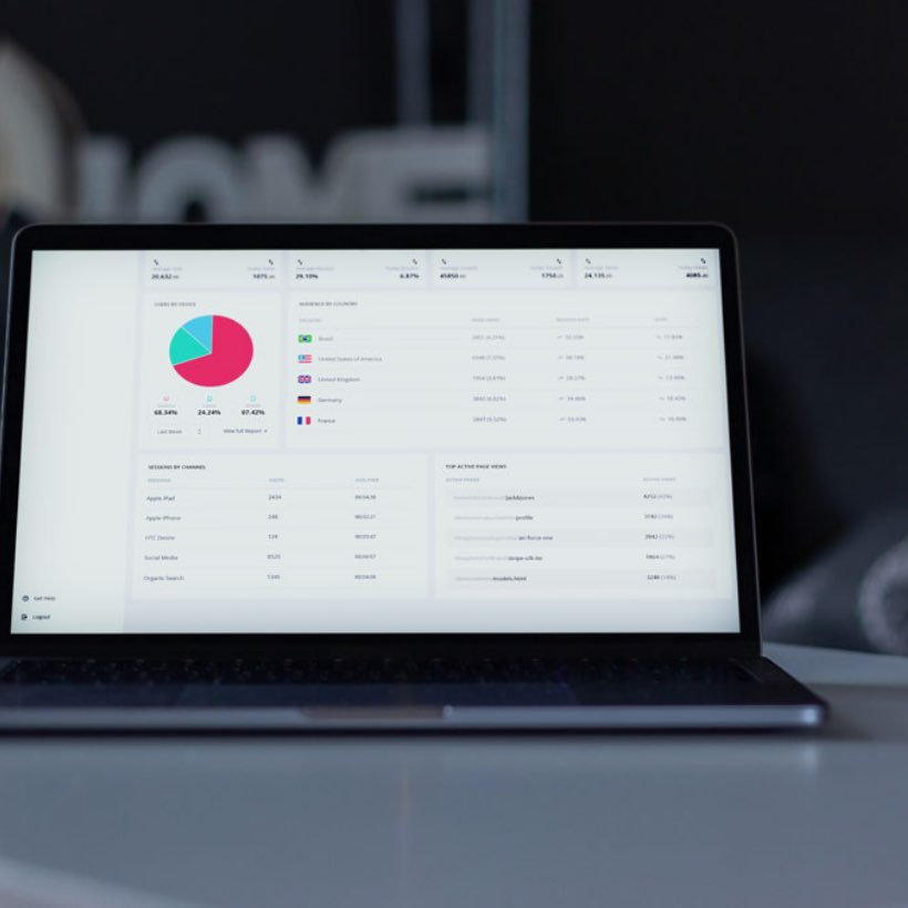 Logistics stats on a laptop screen.