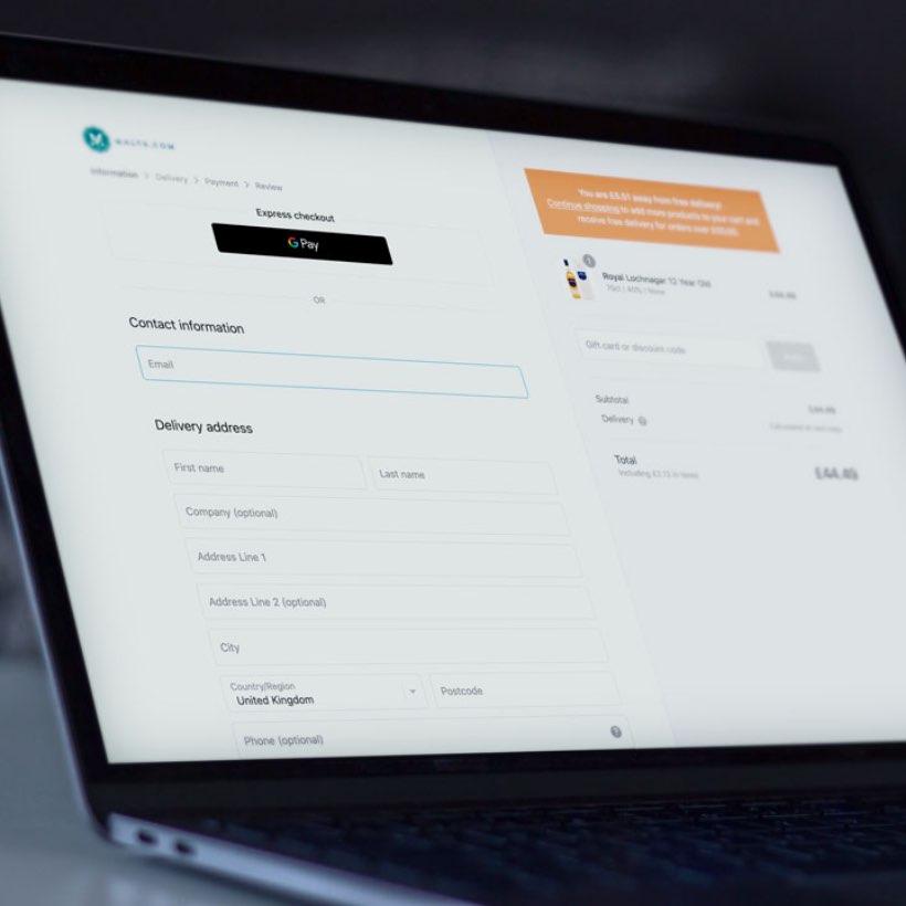 Malts.com checkout screen on laptop.