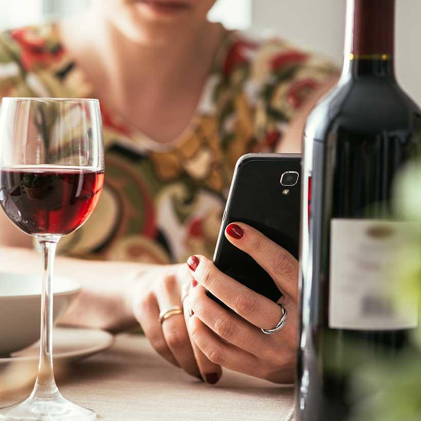 Woman using wine app.