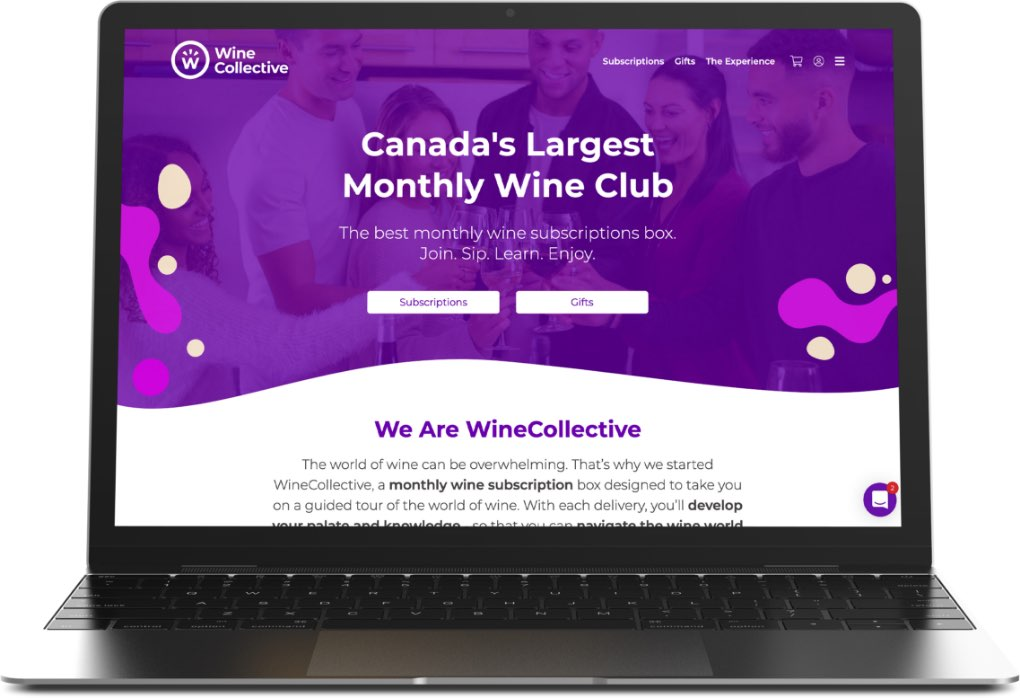 Wine Collective website on laptop.
